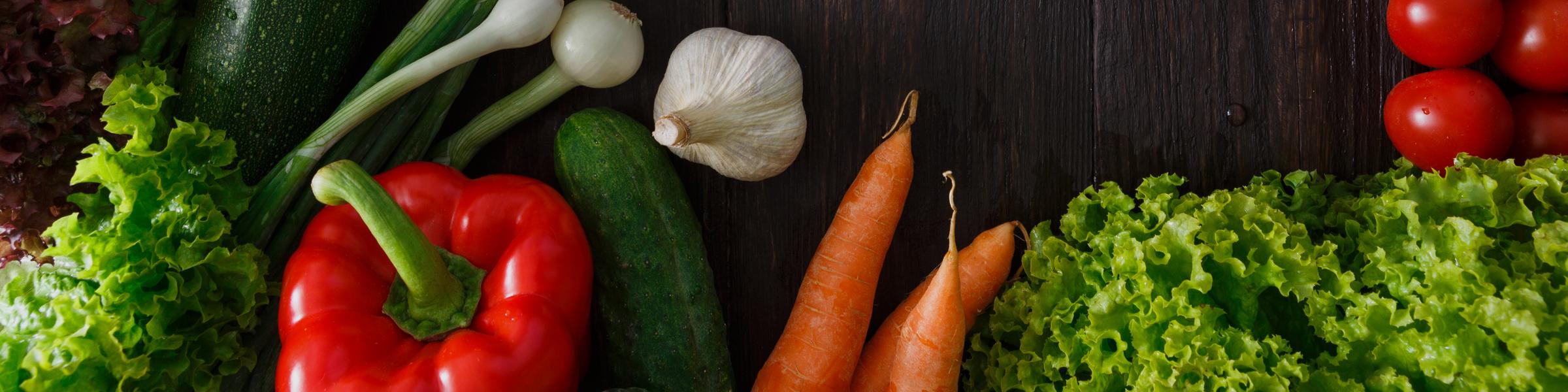 Arrangement of vegetables on a wooden background.